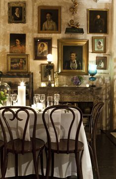 #vintage table...this room reminds me of my living room in mood and tone. And yes, we do dine there, who wouldn't?