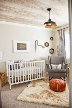 Masculine baby boys room. Faux wood plank wallpaper on ceiling, cool curtain panels