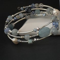 I have used a carefully selected mix of semi-precious gemstones - aquamarine, agate & moonstone, alongside pearls and crystals to create this one-of-a-kind bracelet. These gemstones have been added to three coils of memory wire, that is 60 mm in di. Memory Wire Jewelry, Memory Wire Bracelets, Jewelry Bracelets, Bracelet Fil, Wire Wrapped Bracelet, Handmade Jewelry Designs, Handcrafted Jewelry, Handmade Jewellery, Gold Jewellery