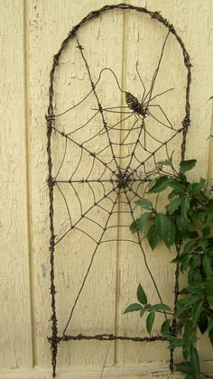 Spinning Spider In A Web Barbed Wire Garden Trellis @ thedustyraven on Etsy