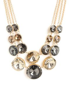 It doesn't get more awesomely audacious than this. With its bold bib silhouette and gigantic gobstopper gems, in smoky gray and citrine hues, this necklace is pure extravagance.