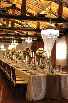 Alright... lets chat table cloths. I like the burlap runner and the cream/light brown table cloth. I am thinking ivory for mine... I want to leave the 'dark brown' look for the folding chairs.