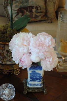 A vase of soft pink Peonies is the perfect accent in a formal setting.