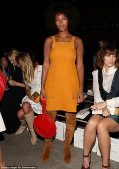 Solange Knowles stuns in bright orange frock and thigh-high suede boots at the Zimmermann NYFW show - http://www.nollywoodfreaks.com/solange-knowles-stuns-in-bright-orange-frock-and-thigh-high-suede-boots-at-the-zimmermann-nyfw-show/