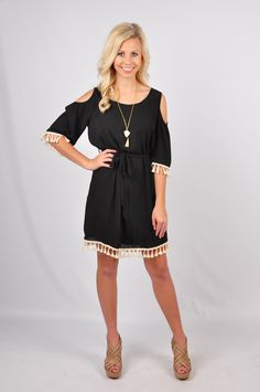 This black dress features an open shoulder and a fun tassel detail on the hem line! It has a tie at the waist and an open keyhole detail on the back at the neck! 70% Silk 30% Polyester