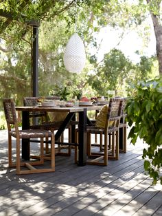 Colo Dining Table in distressed teak ($2499) paired here with the Balfour Dining Chair ($399 each). #outdoorfurniture #outdoorfurnitureideas #outdoordesign #outdoordesignideas