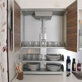 The Verti shelving lift system enables shelving from upper kichen wall cabinets to be lowered to counter height providing easy access for people sitting or in a wheelchair.