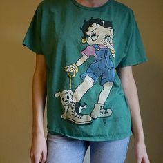 Vintage badass Betty Boop tee Please read my rules (listing at the top of my closet)---- aaaaaawesome graphic on this vintage men's tshirt. Worn oversized by girls. Natural signs of wear but no stains. Vintage Tops Tees - Short Sleeve