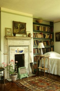 Virginia Woolf's bedroom with books. At Monk House, UK