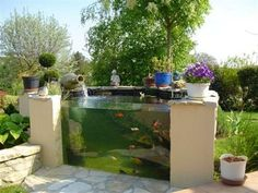 A koi pond is a great addition for your patio or living room. Learn more at https://www.divesanddollar.com/above-ground-koi-pond/ to find more beautiful above ground koi pond ideas. #koi #koipond #pond #abovegroundpond #homeimprovement