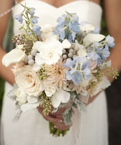 Pretty light blue and peach wedding bouquet.  Shared from:  http://theeverylastdetail.com/beach-chic-light-blue-peach-wedding/#_a5y_p=1041425
