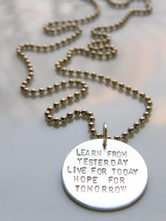 Silver necklace with text