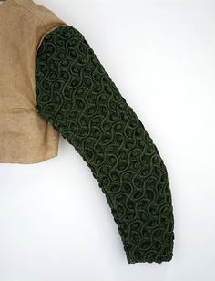 Sleeve (England) ca. 1600-1625 Embroidered and appliquéd silk, with cording and glass beads