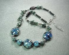 """Ta-da!  A necklace to match the earrings.  This necklace, christened """"Aquarius"""", is once again made with my very own hand-crafted lampwork beads."""