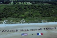 Past memorial event at Omaha Beach presented by The French Will Never Forget.