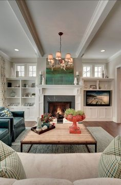 fireplace with small high windows on sides and built-ins underneath