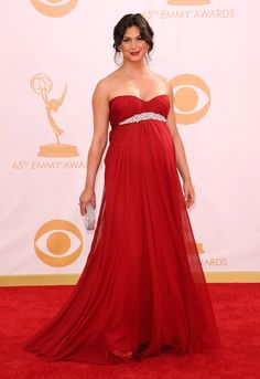Homeland star Morena Baccarin was radiant on the red carpet for the 2013 Emmys on Sept. 23. The actress wore a gorgeous floor-length red gown with crystal embellishments at the bust.