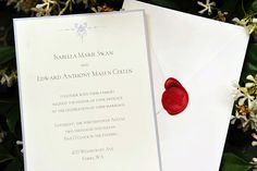 Custom Wedding Invitations  (Love the silver metallic border and the red wax seal)