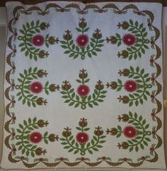This beautiful quilt is entirely hand appliqued & quilted.  It goes by several names ~Rose Tree, Missouri Rose,  Prairie Flower, Mississippi...