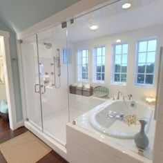 Wow!! Now that is a bathroom~ Enclosed tub/shower combo - just need dual shower heads and different tile and this is perfect. If wall next to tub was a connecting wall with the bedroom you could have a fireplace that's visible on both sides...