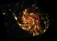 Messier 101, also known as the Pinwheel Galaxy, seen at ultraviolet and optical wavelengths, in an image taken by ESA's XMM-Newton space telescope. A new study looked at the Pinwheel Galaxy in hopes of finding evidence of dark matter interactions with light.