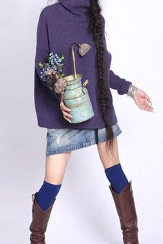 This jumper crafted in wool and acrylics, featuring high collar, long sleeves, in medium length cut.$103