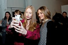 A model takes a selfie with Olivia Palermo backstage at the Tibi fah Mercedes-Benz Fashion Week Fall 2014 at Pier 59 on February 8, 2014 in NYC
