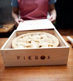 Reusable raw pine box designed to safely transport pie.