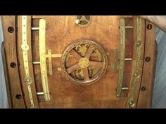 """Brass and wood """"pressure door"""" with iris, handwheel 