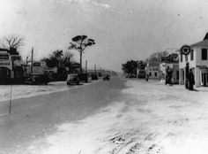 This file photo taken about 1939 shows the west side of Main Street in Fort Walton. The Buckhorn Inn on right.