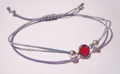 Dainty Red Swarovski Crystal bracelet on adjustable grey thread   A wonderful little gift for that special someone or a perfect present for your