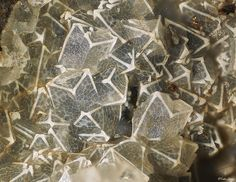 This is a rare type of faujasite twin crystals with white edges and coating over clear crystals.