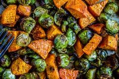 Roasted Sweet Potatoes and Brussels Sprouts Recipe Side Dishes with brussels sprouts, sweet potatoes, garlic, olive oil, cumin, garlic salt, salt, pepper, red wine vinegar, fresh thyme