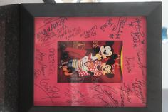 Disney autographs on picture frame mat and then picture from trip in the middle.