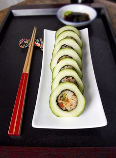 Beautiful, unusual, light and crunchy appetiser... a sushi roll inside a hollowed out cucumber. The tricky part is to make the nori wrapped fried rice nicely fit into the cucumber....the trick is to twist it in, just like with a screw. For the full recipe and instructions follow the link...