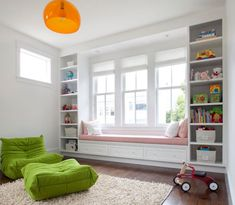 Apple green Togo Sofa coupled with bright orange FLY pendant. #Pendantlight #Lighting http://www.shelights.com.au