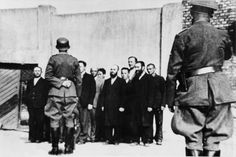 Jewish residents of Šiauliai, Lithuania are assembled for execution near the Kuzhyay train station, July 1941. Lithuania was among the first killing grounds assigned to the Einsatzgruppen, the SS killing squads sent into Eastern Europe.