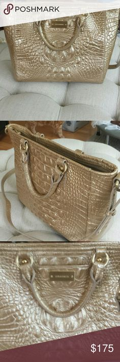 Brahmin bag Beautiful gold Brahmin bag one pocket on the outside two zip pockets on the inside to regular Pockets to pen holders one key fob beautiful condition has the long strapped we're over your shoulder or the regular handles 12 inches across the top 9 inches high Brahmin  Bags Shoulder Bags