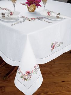 Palm Beach - Luxury Table Cloths - Designed to transport your guests to an idyllic place in their minds, lovely seashells and beach flora are skillfully embroidered by hand on fine White Italian linen. #TableLinen #TableCloth #schweitzerlinen