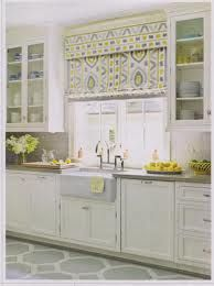 house beautiful like window treatment, rug, grays and yellows