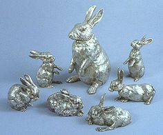 """A silver pitcher shaped as a rabbit standing on its hind quarters, with hinged head, gilt interior & cabochon ruby eyes - stamped with Imperial Warrant mark of Fabergé, assay mark of Moscow 1894, assay master A. Svetchin, 88, height 9 ¾"""".. This pitcher & the six rabbits that follow were formerly in the collection of King Ferdinand of Bulgaria (1861-1948), one of Fabergé's most important clients. While several similar pitchers exist, no other such group of rabbits seems to have survived."""