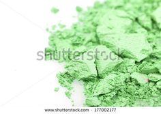 Crushed eyeshadows on white. Beauty concept - stock photo