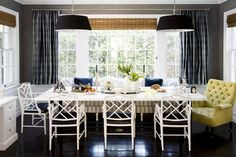 Banquette seating, drum shade lighting...perfect dining room