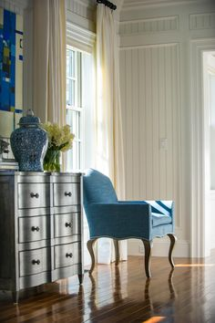 """When we were furnishing the home, we jazzed it up a little bit,"" explains Linda. ""We have a traditional living room with an edge, and we kept it very monochromatic with grays, blacks and whites. We pulled in some of that blue because we know we are in a resort area, and we wanted to celebrate that kind of sense."""