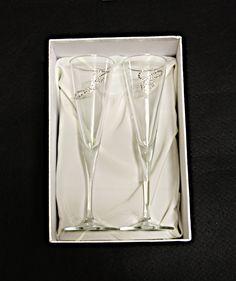 Dos copas de cristal para cava personalizadas, decoradas con cristales de swarosvki y empaquetado especial.         Color: Transparente.    Tamaño:19 x 28.5 x 11 cm    Peso:781 gr Este artículo está registrado en el registro de propiedad intelectual Safe Creative.  © Todos los derechos reservados.