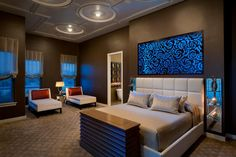 This custom, lighted panel behind the bed brings together an eye-catching light fixture, captivating artwork and modern sophistication with a bit of edge to create a dramatic focal point for the Master Bedroom. This designer created the pattern for the laser-cut wood panel, slightly evocative of an Asian floral motif, which was inspired by the client's cultural heritage.