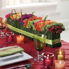 Modern, clean and colorful with the horsetail lined container and repeating rows of hypericum, roses, dahlias, mini hydrangeas, gerberas, stock. Very nice.