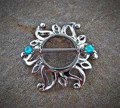 Check out this item in my Etsy shop https://www.etsy.com/listing/465357498/sun-opal-teal-nipple-shield-nipple-ring