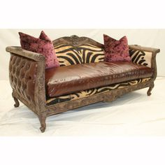 This unique and exotic sofa will wake up any room! Attention to detail like old world finely carved trim, tufted sides and striking faux fur upholstery guarantees this unique piece...
