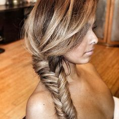 fish tail braid. I wish my hair wad thick like this so I could do this, I'd have to grow out my hair first too though